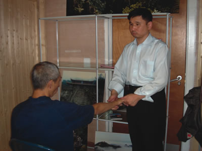 Zhu Gang, the Vice-Chairman of China Massage Association of Blind Practitioners massaging a client