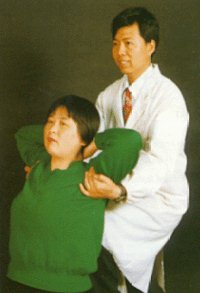 Here the patient is receiving an upper back manipulation