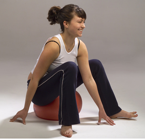 C.    (Sitting up) Spiraling Exploration: Sit on a soft almost deflated ball (I like Slo-mo fitness balls) on the floor or on a flat chair.