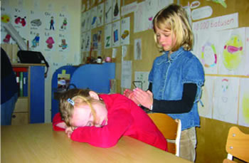 Children performing massage