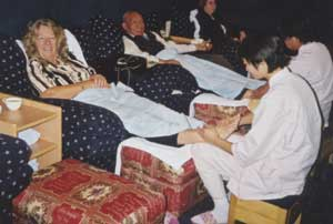 Receiving treatment at Reflexology Clinic Beijing