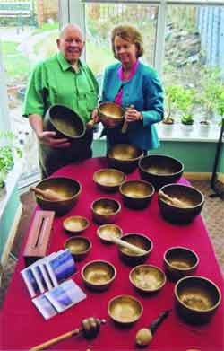 The authors with a diverse selection of Tibetan bowls