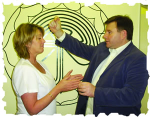 Geoff Merrigan demonstrating part of a healing strategy to a Complementary therapist