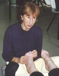 Helen Perkins vocalizing with intuition and sound reflexology during a treatment
