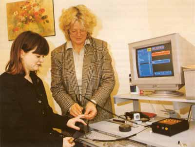 Anne Smithells (right) using the LISTEN System to screen a patient for food intolerances.