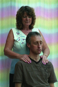 The author performing seated Angelic Reiki