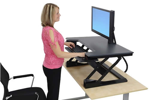 Woman at Sit-Stand Desk