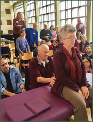 Dr Smith demonstrating seated evaluation of the sacra-iliac joint at ZB & Consciousness, Newton, Massachusetts, 2016