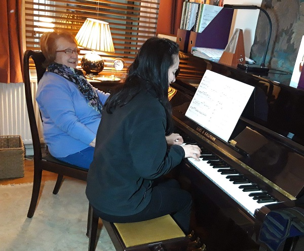 Author giving Piano Lesson