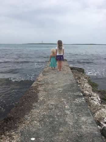 Children at the end of the pier